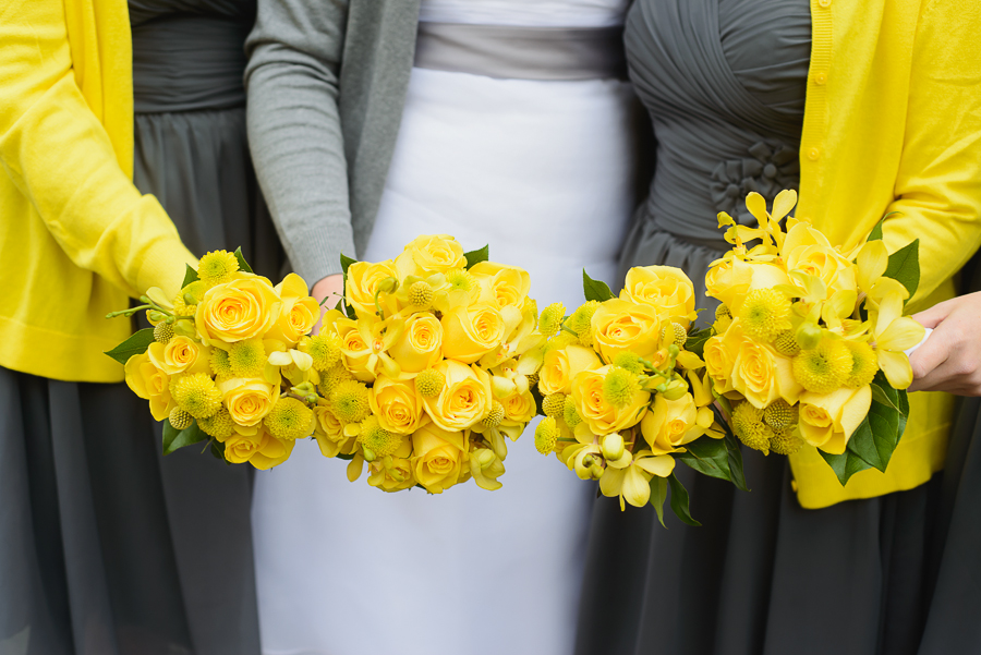 wedding at False Creek Yacht Club | bridesmaids wearing yellow cardigans and grey bridesmaid dresses with yellow rose bouquets