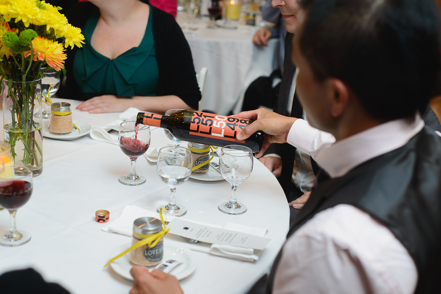 FCYC wedding | wedding guest pouring red wine at wedding reception