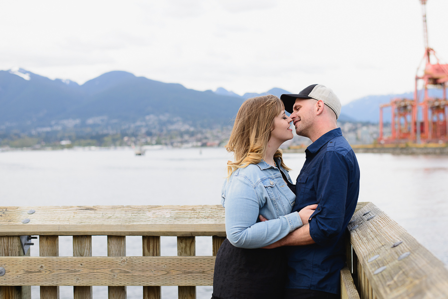 Gastown engagement photo | couple on pier at Portside Park