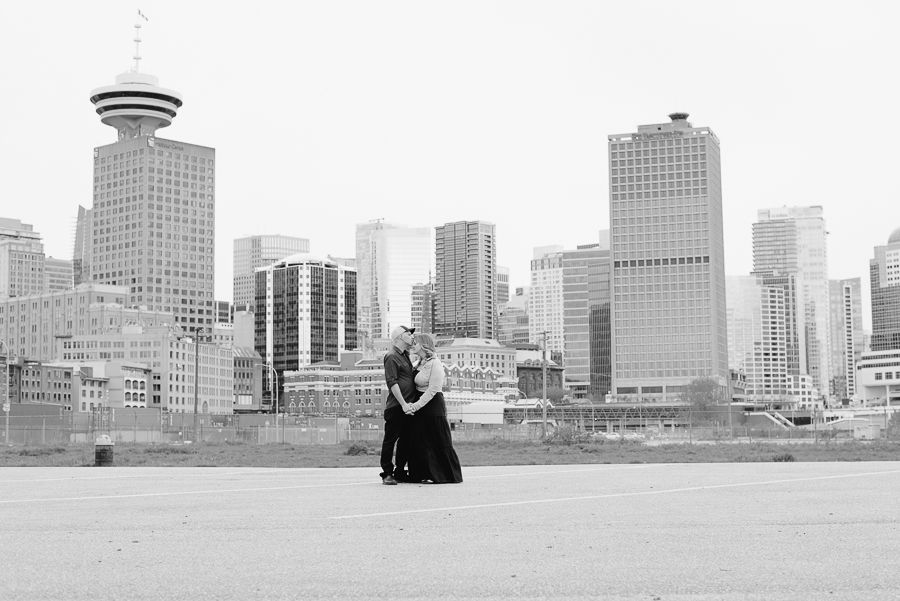 Gastown engagement photo | couple at Portside Park with Vancouver cityscape