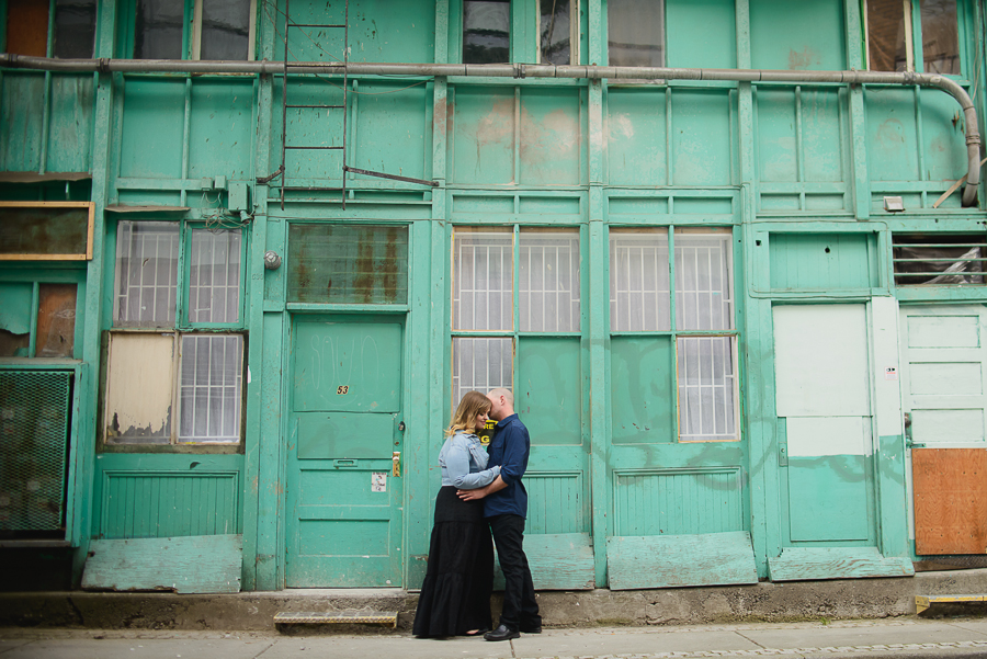 Gastown engagement photo | turquoise building in Chinatown