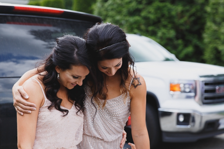 bridesmaids hugging before wedding ceremony