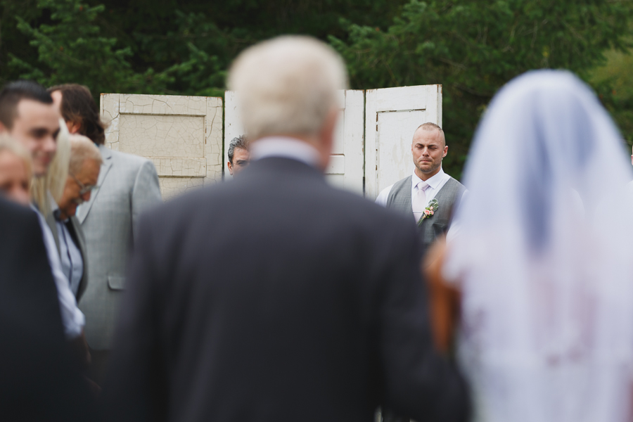 groom crying as bride comes down the aisle