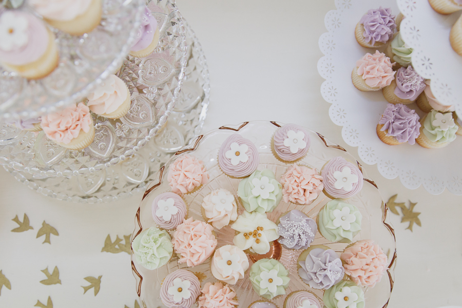 pastel pink, purple, and green cupcakes on shabby chic cupcake towers and vintage cake stands