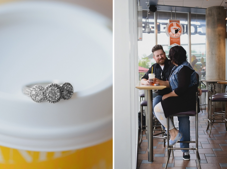 three stone halo engagement ring on coffee cup