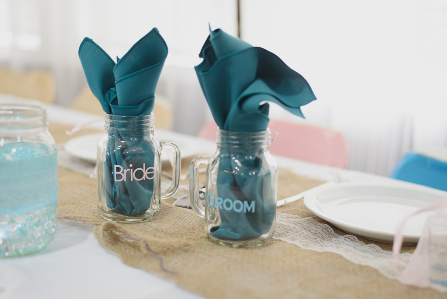 custom bride and groom mason jars with handles with turquoise cloth napkins