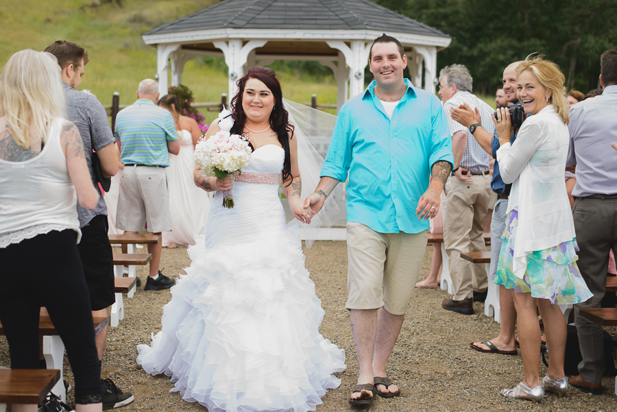 bride and groom with tattoos recessional after rustic gazebo wedding ceremony at Grandview Acres in Kamloops, BC