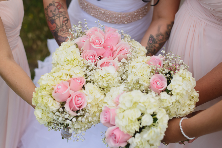 bride and bridesmaid bouquets   pink and white roses and baby's breath rustic wedding bouquets