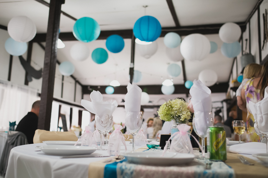 white, light blue, and turquoise paper lanterns at rustic wedding reception