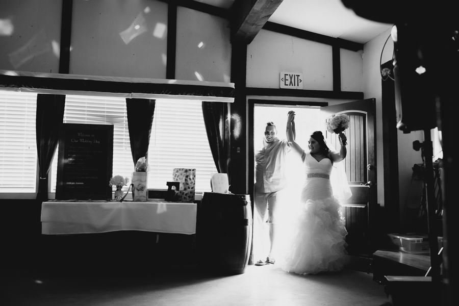 bride in ruffled one shoulder wedding dress and casual groom grand entrance
