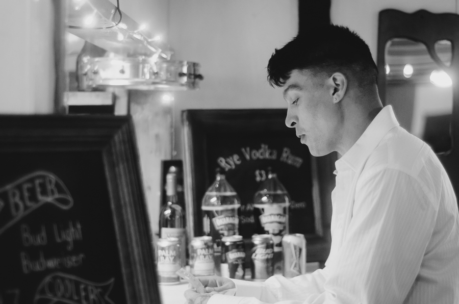groomsman at bar during wedding reception