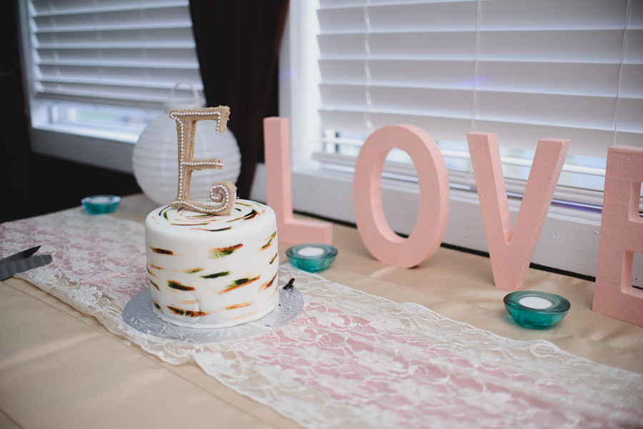 rustic white wedding cake with whimsical burlap and pearl monogram cake topper