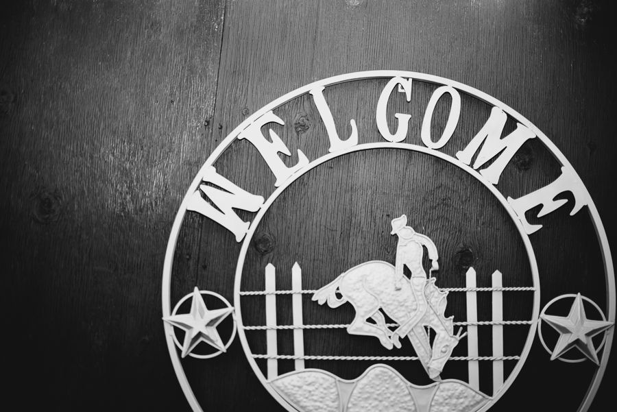 western cowboy welcome sign at rustic wedding at Grandview Acres in Kamloops, BC