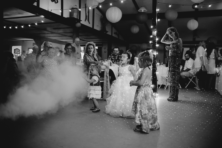 children and guests on dance floor at wedding surprised by fog coming from DJ's fog machine