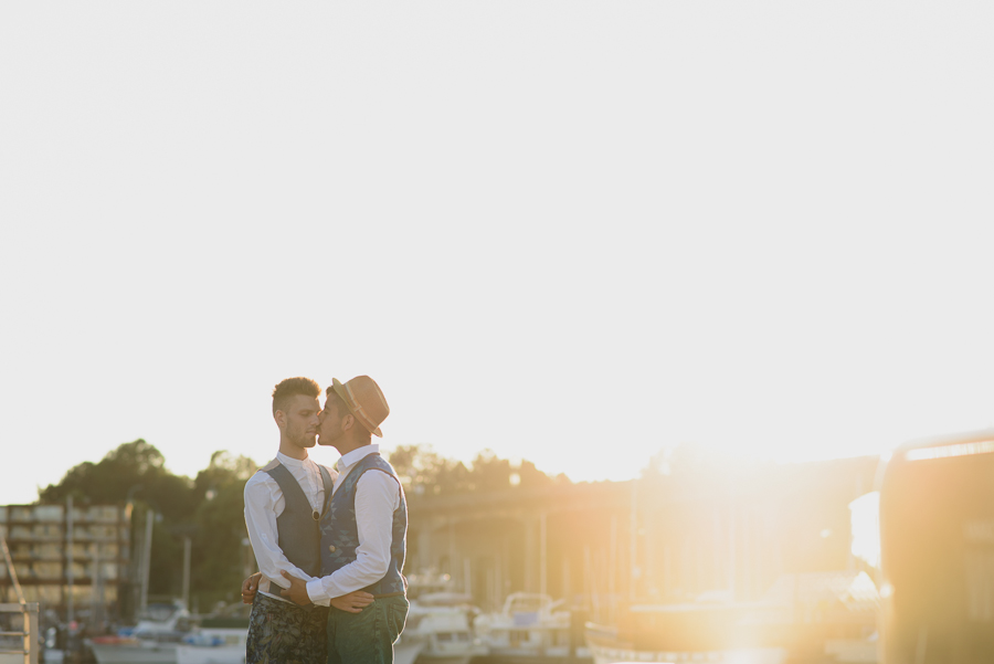 gay couple kissing at sunset on Granville Island | LGBT wedding photographer