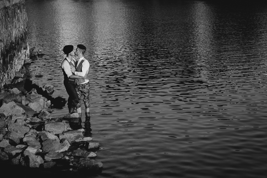 same-sex couple kissing and standing in ocean | same-sex anniversary session