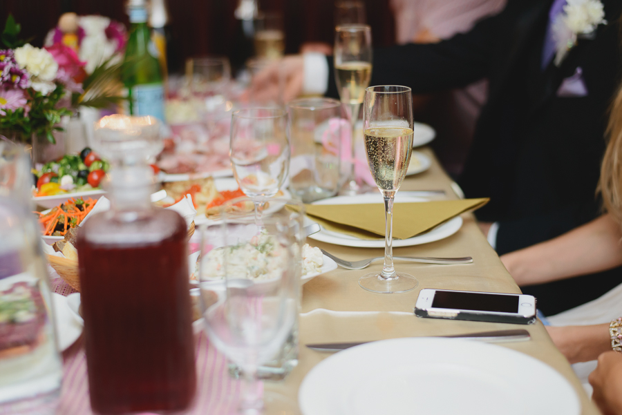 glass of champagne at head table at wedding reception