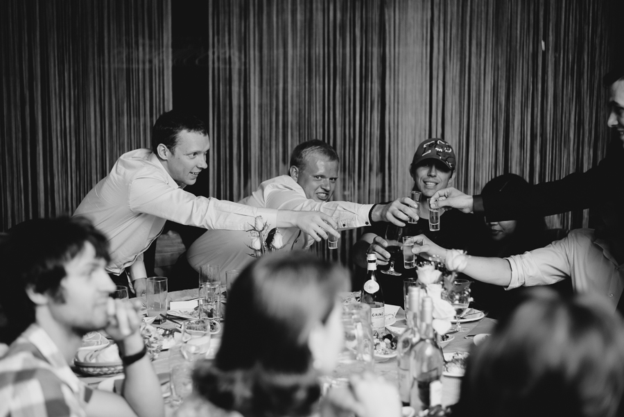 guests cheersing with shot glasses at wedding reception