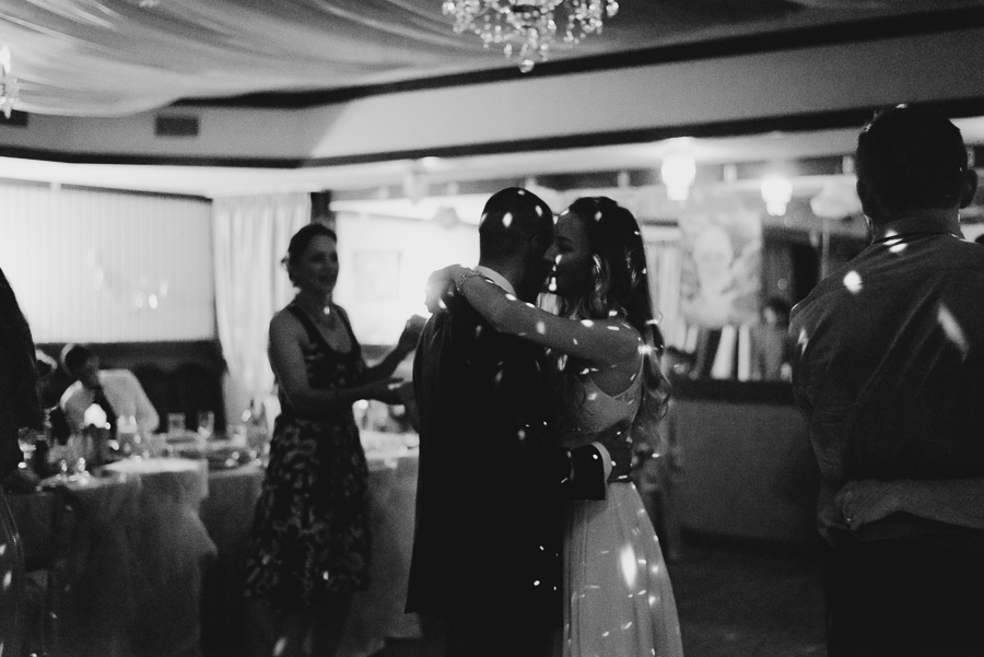 black and white photo of bride and groom first dance with dance lights
