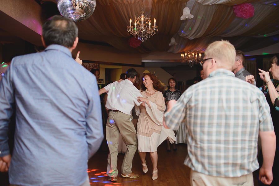 mother of the bride dancing in the middle of the dance floor at wedding reception
