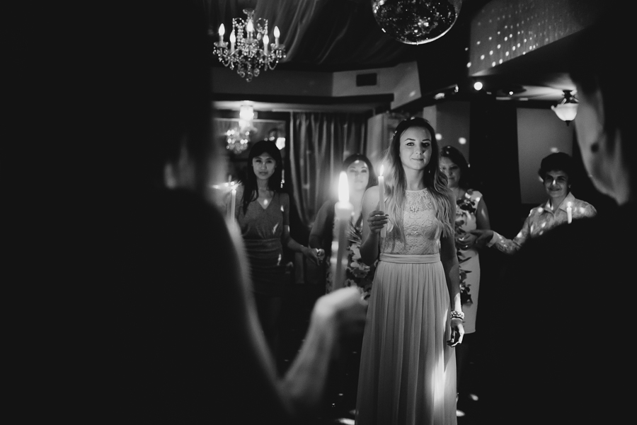 bride in middle of circle during candle ceremony at wedding reception
