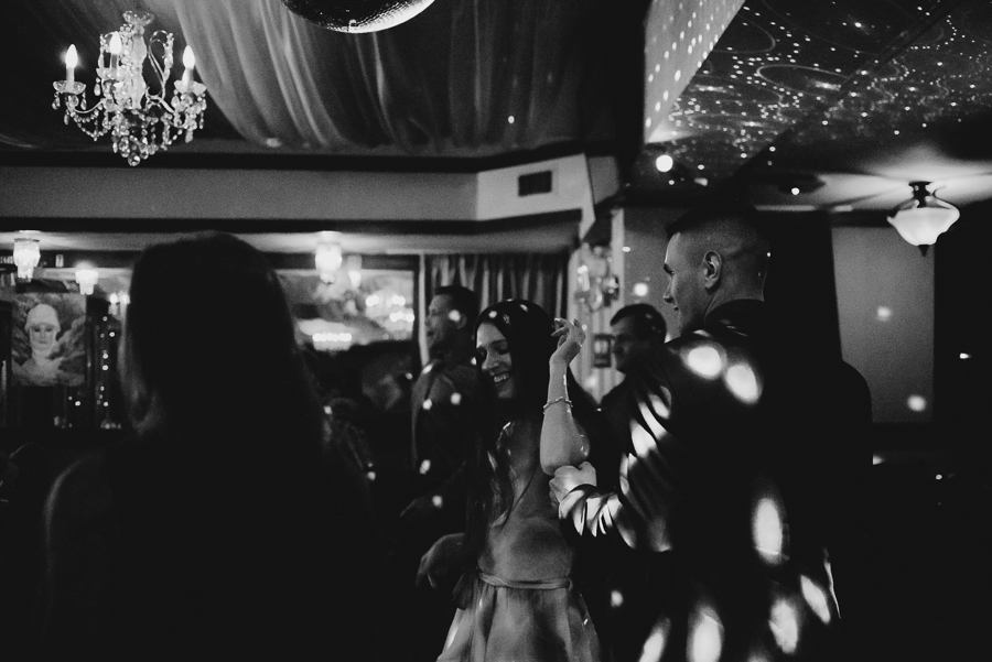 guests dancing at wedding reception with dance lights
