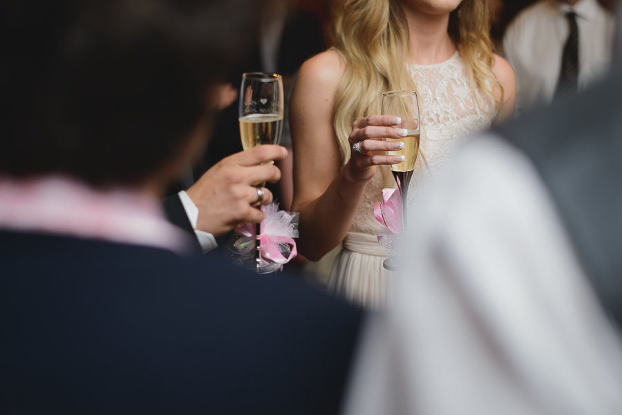 bride and groom toasting with customized champagne glasses