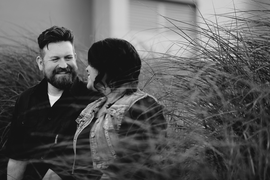 couple smiling in garden in Surrey Library courtyard engagement photo