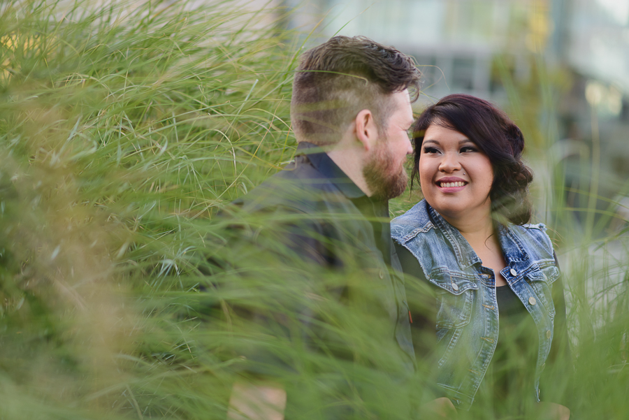 couple sitting in garden in Surrey Library courtyard engagement photo