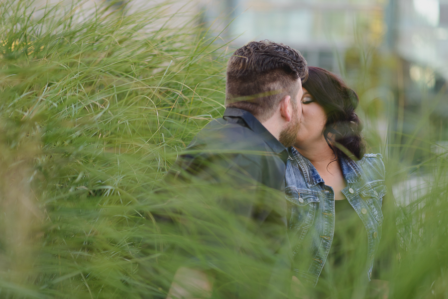 couple kissing in garden in Surrey Library courtyard engagement photo