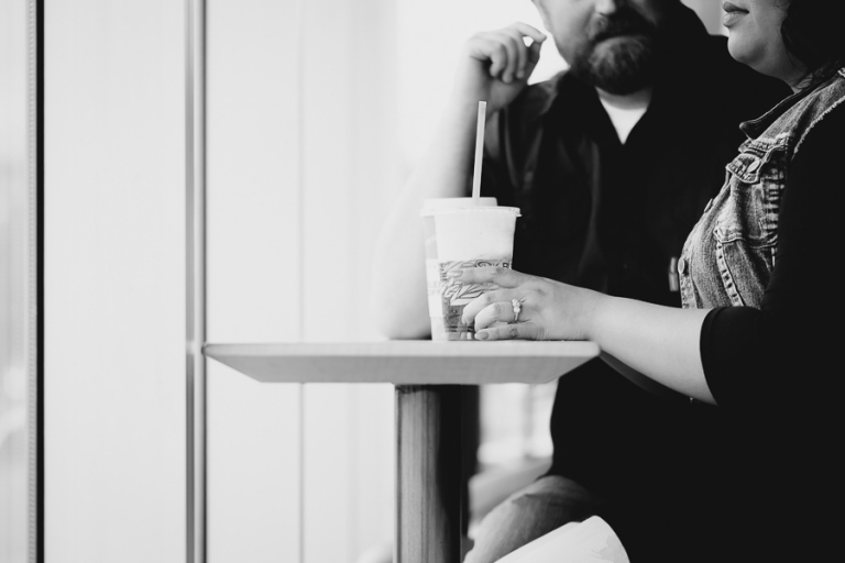 three stone halo engagement ring coffee shop engagement photo
