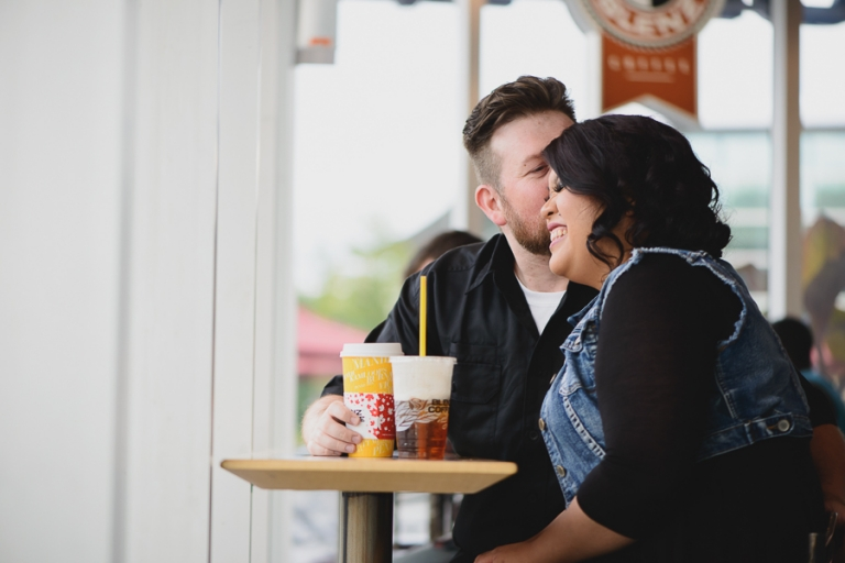 couple kissing at Blenz coffee shop engagement photo
