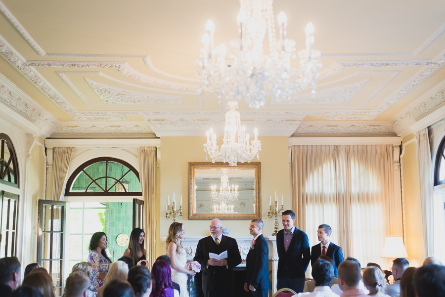 wedding ceremony in drawing room at Hycroft Manor wedding in Vancouver, BC