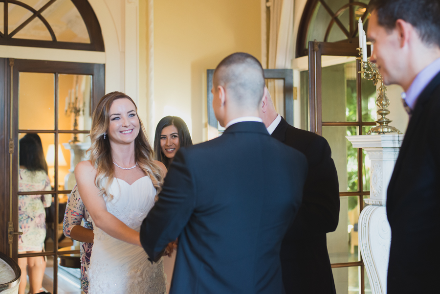 smiling bride in drawing room at Hycroft Manor wedding in Vancouver, BC