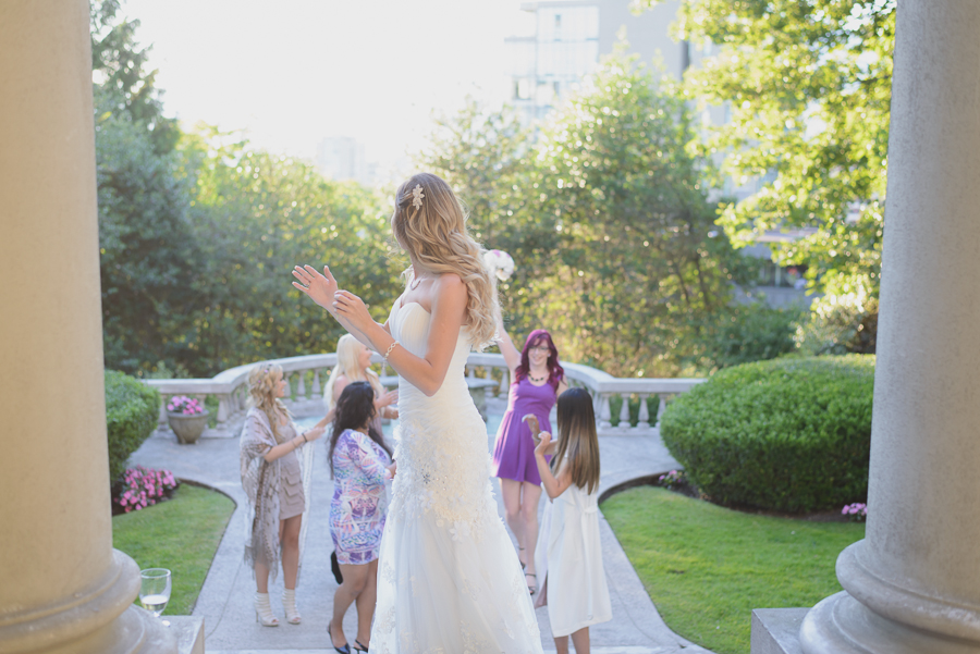 bridesmaid catching bouquet at Hycroft Manor wedding in Vancouver, BC