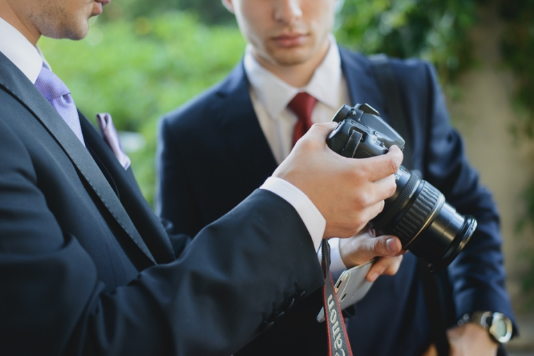wedding guests with Canon camera