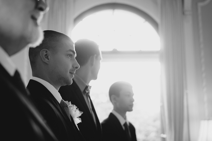 groom waiting for bride at end of the aisle