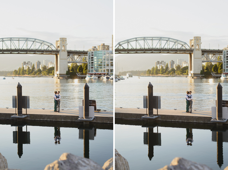 gay couple on dock with reflection in front of Burrard Street Bridge on Granville Island