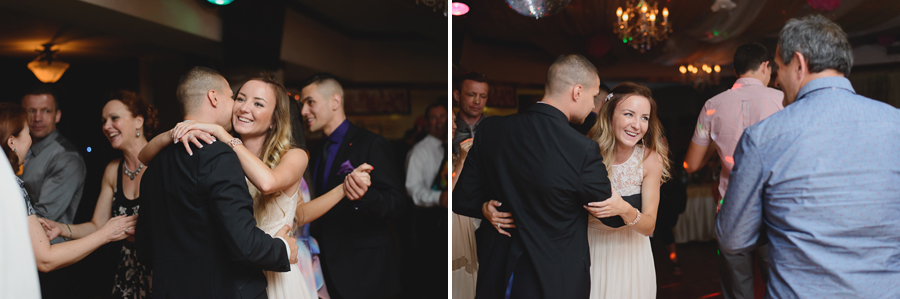 bride laughing while dancing with groom and guests at wedding reception
