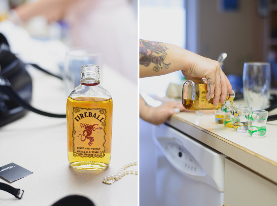bride pouring shots of Fireball while getting ready with bridesmaids before wedding