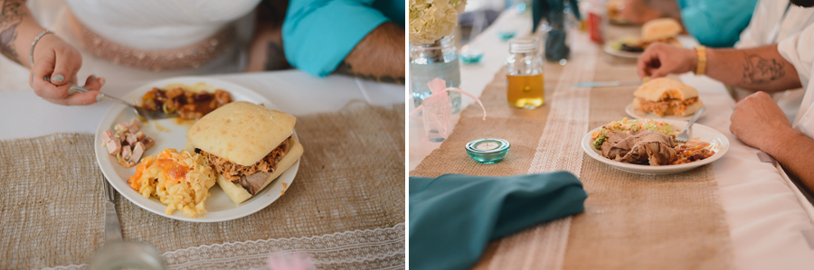 bride and groom and wedding party eating BBQ wedding dinner on burlap table runner at rustic wedding