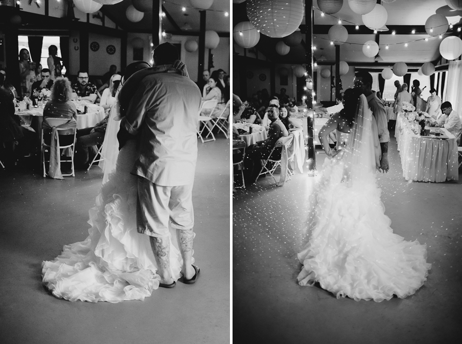bride in ruffled one shoulder wedding dress and long veil dancing with groom during first dance