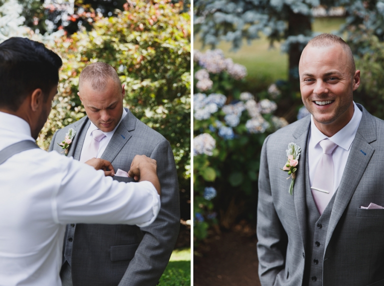 groomsman helping groom with pocket square