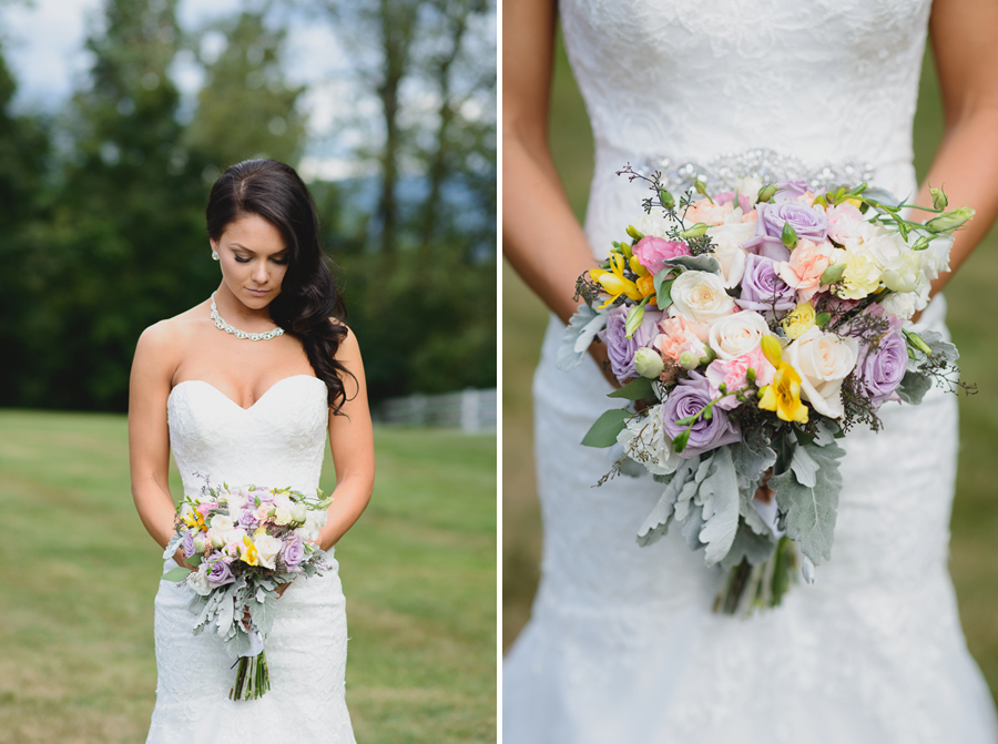 bride in sweetheart neckline lace fit and flare dress with rustic pink, purple, and white bouquet with greenery and foliage
