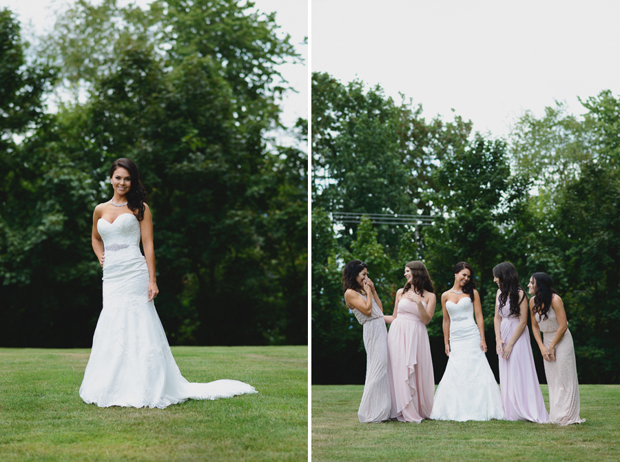 bride in sweetheart neckline lace fit and flare dress with bridesmaids in mismatched pink bridesmaids dresses