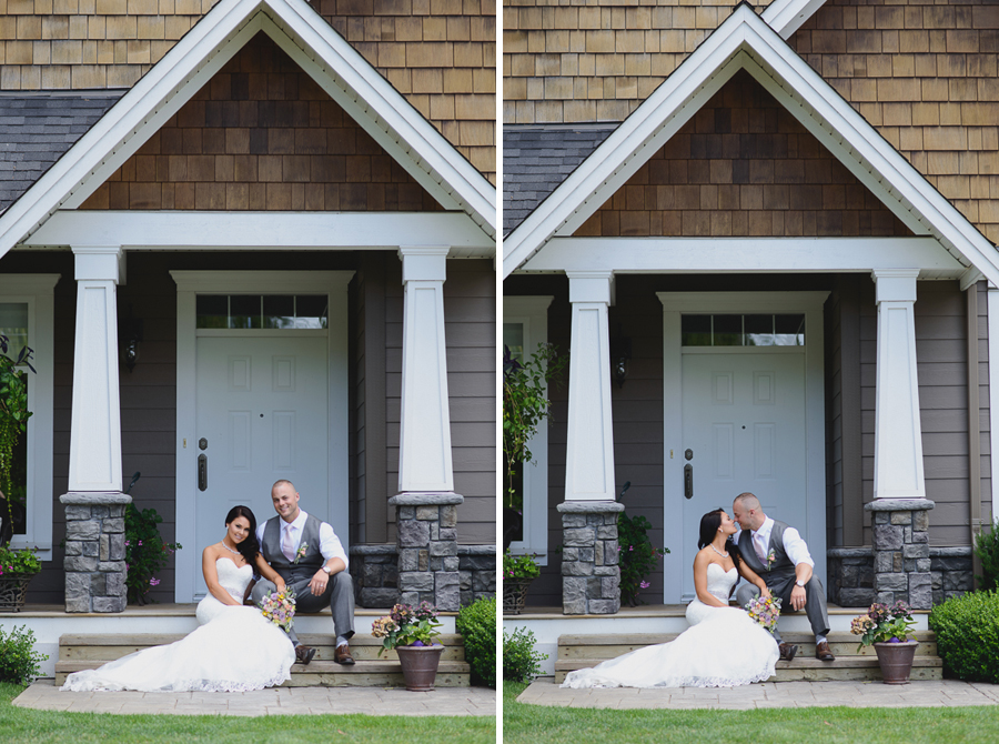 bride in lace fit and flare dress and groom in grey vest with light pink tie kissing on porch