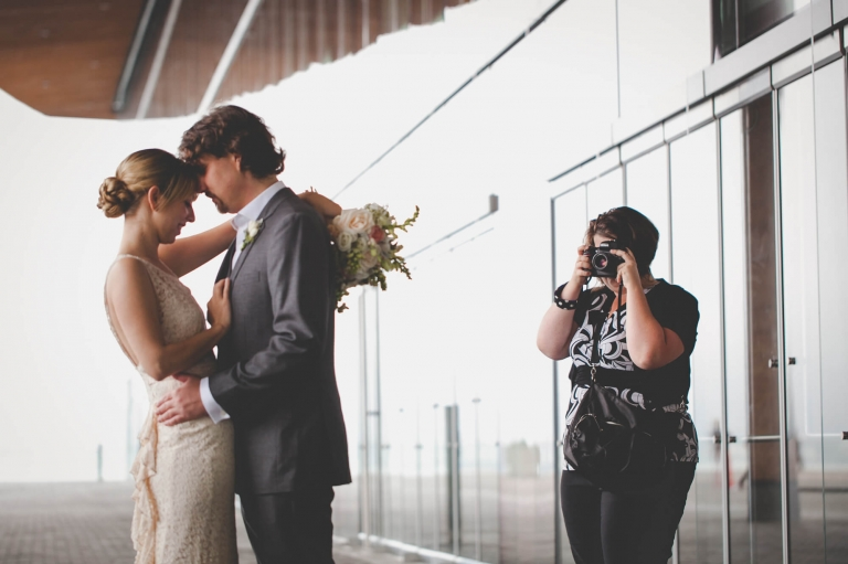 Vancouver wedding photographer behind the scenes shooting bride and groom portraits at Vancouver Convention Centre