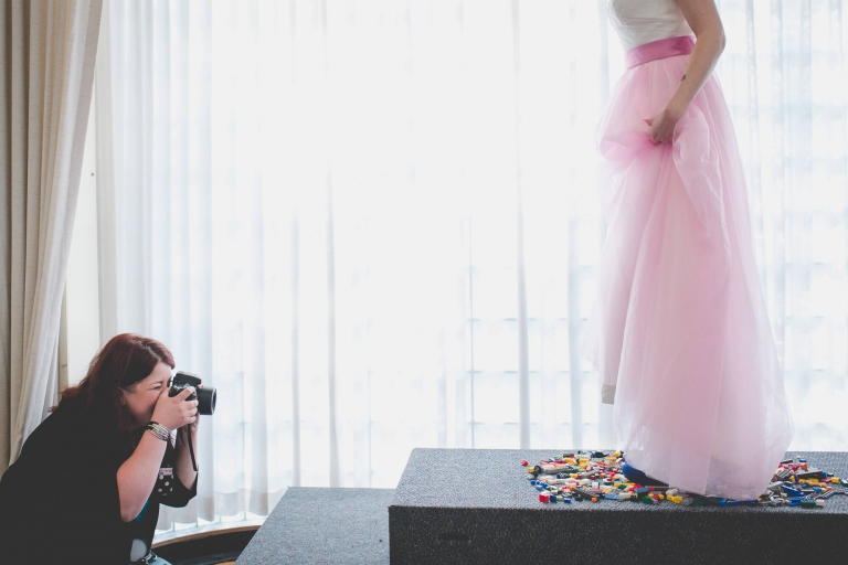 Vancouver wedding photographer behind the scenes shooting a bride in a pink wedding dress