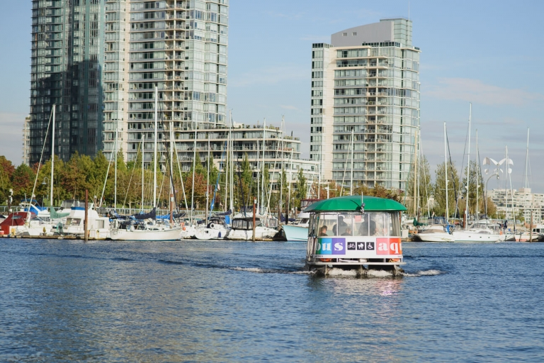 groom and wedding guests arriving for Granville Island wedding on Aquabus