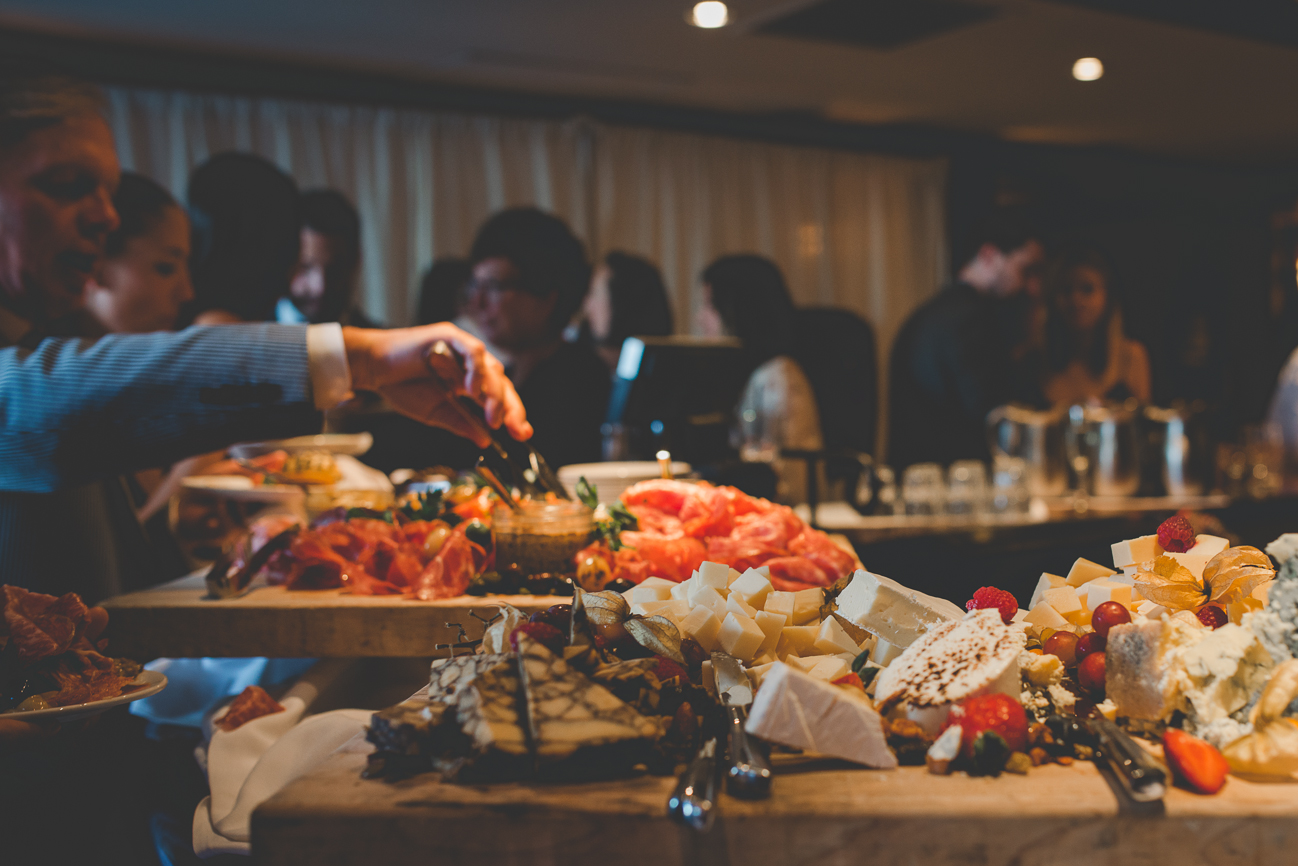 guests in line for drinks and cheese plate at Dockside Lounge wedding reception